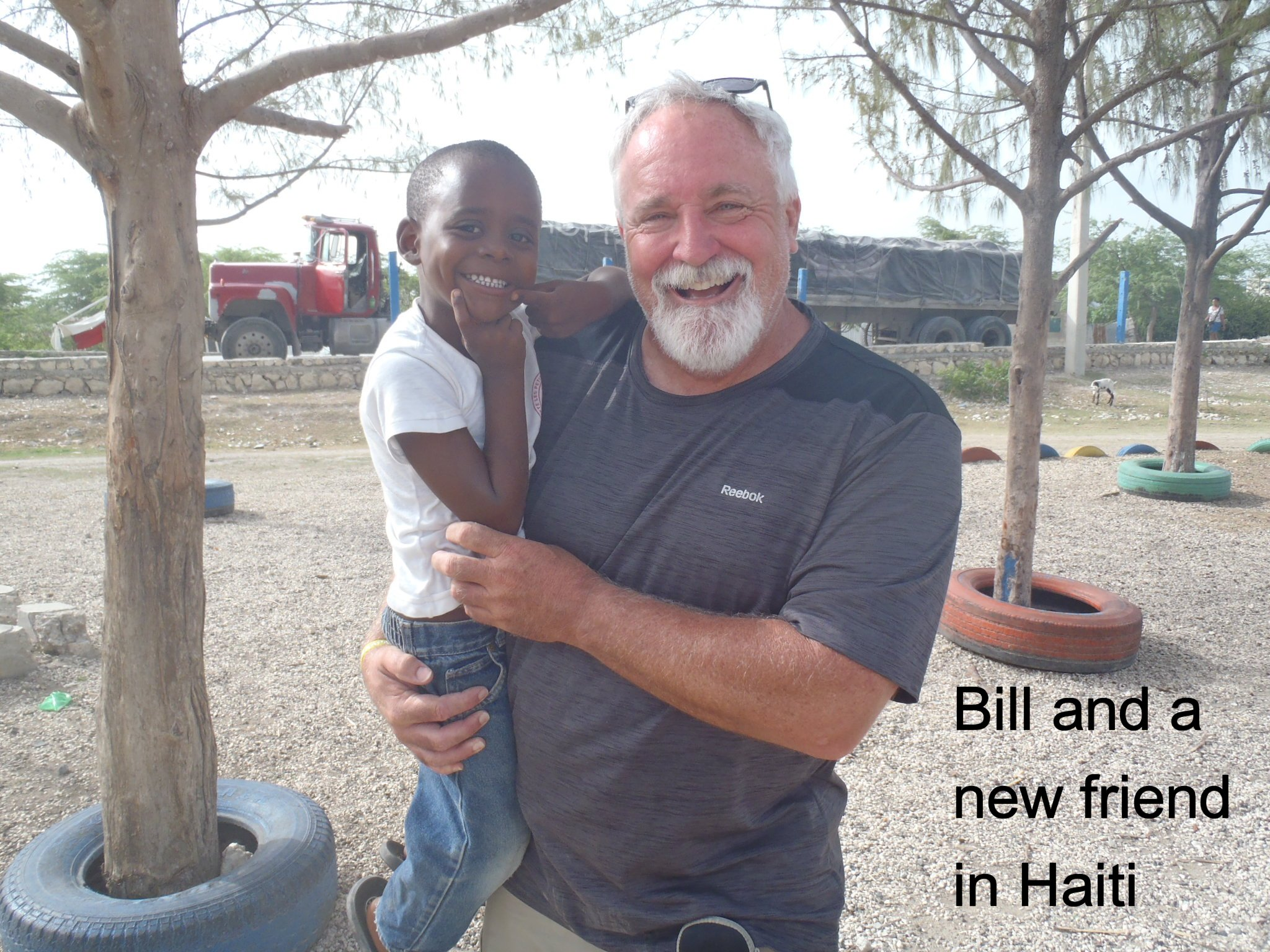Bill and friend in Haiti