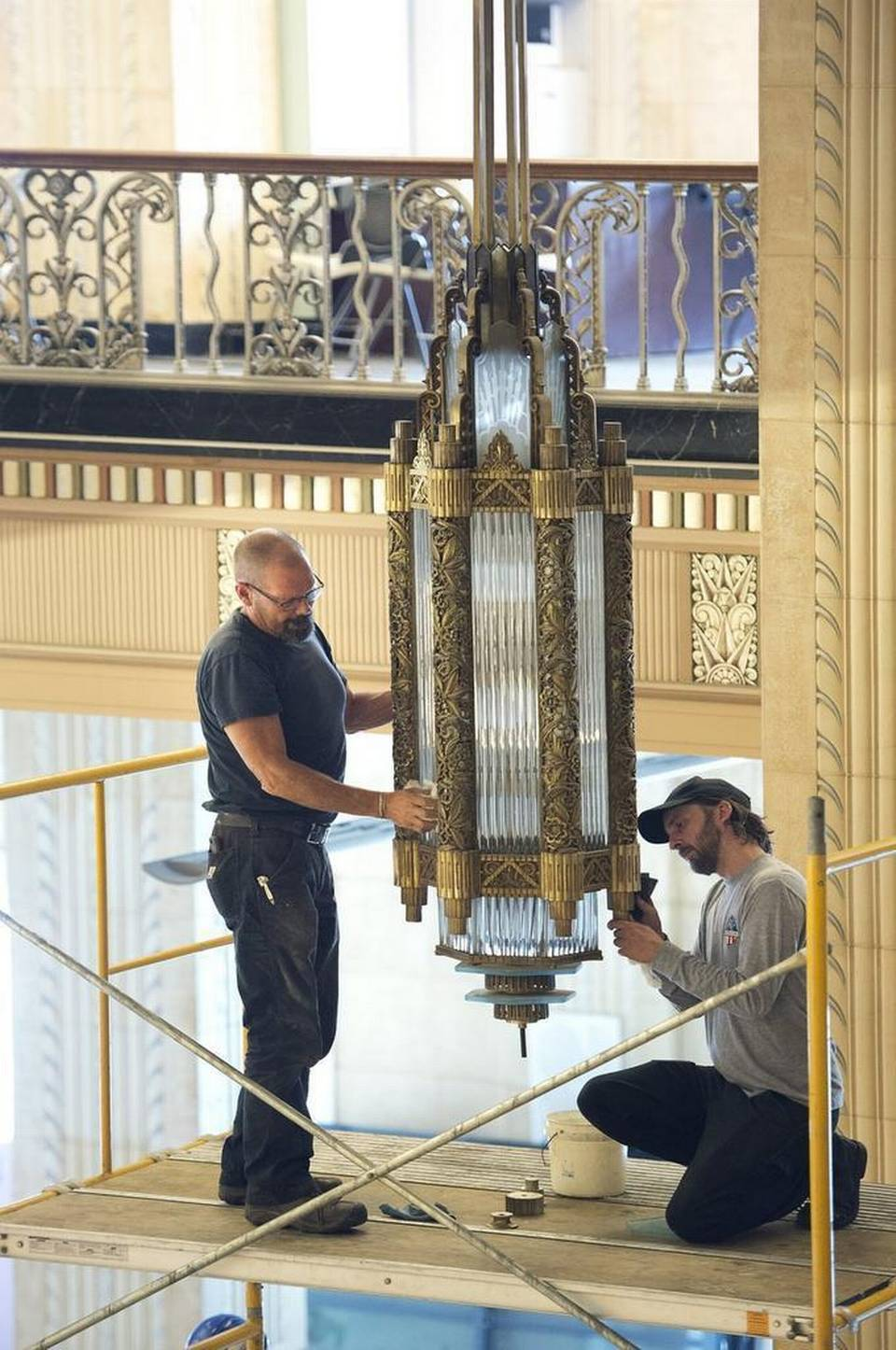 Matt & Robert refinishing chandeliers