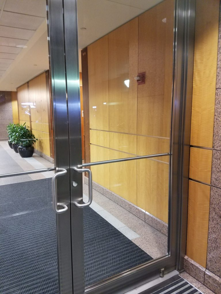 An inviting stainless steel entrance to the Block 89 Building