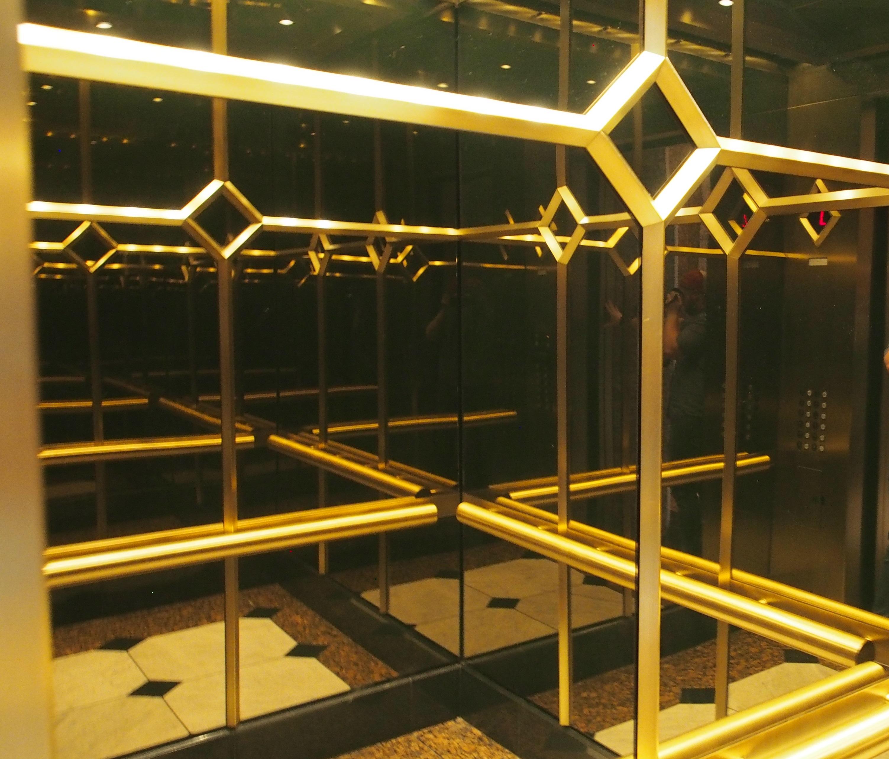 Bronze and stone elevator cab interior